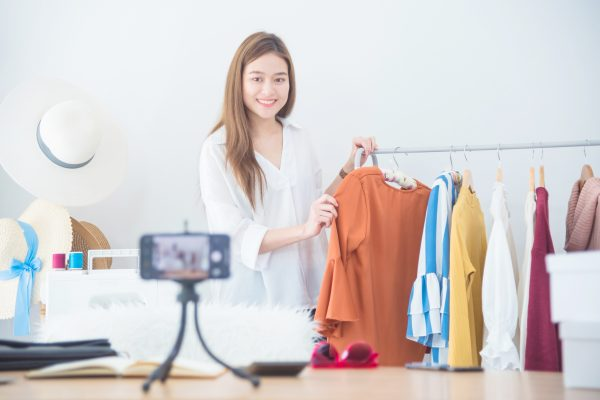 Woman showing clothes off on online video